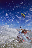 Man kiteboarding in high speed