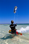 Kitesurfer with kite surfing the waves, Djerba, Tunesia