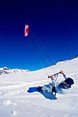 Man kiteboarding in snow, Lermoos, Lechtaler Alpen, Tyrol, Austria