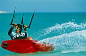 Man kiteboarding at great speed