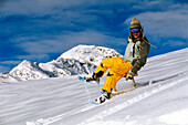 Young woman on skifox moving down, Serfaus, Tyrol, Austria