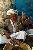 Local coffee dealer weighing coffee beans, Souk of Sana, Yemen