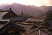 Roofs of the Haein-sa monastery at Kayasan mountains at sunrise, Haein-sa, Kayasan National Park, South Korea, Asia
