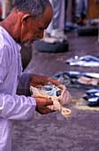 Fish market, beggar, Muscat Sultanat Oman