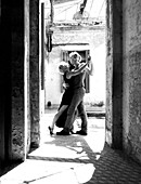 Couple tangoing in a courtyard, Greece, Europe