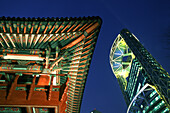 Temple roof next to modern high rise building at night, Millenium Plaza, Seoul, South Korea, Asia