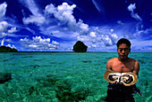 Pearl diver with oyster in the water, Palawan Island, Philippines, Asia