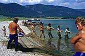 Fishermen pulling net, Lake Baikal, Siberia Russia