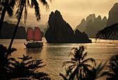Junk at Halong Bay at dusk, Halong Bay, Vietnam, Asia