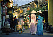 Women at a street at Hoi An, Vietnam, Asia