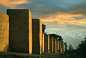 City wall in the evening light and High Atlas, Marrakech, Morocco, Africa