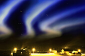 Aurora borealis over farm star traces due to eart, Hemsedal, Oppland Norway, Europe