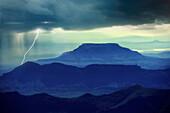 Thunder clouds, lightning and rain over Drakensberge, Kwazulu Natal, South Africa, Africa
