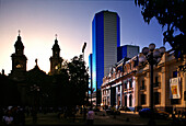 Cathedral and high rise building at sunset, Plaza de Armas, Santiago de Chile, Chile, South America, America