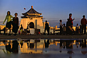People in front of Chiang Kaishek memorial hall in the evening light, Taipei, Taiwan, Asia