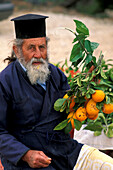Orthodox priest selling oranges, Akamas, Cyprus
