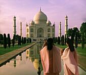 Indian tourists photographing the Taj Mahal in the evening, Agra, Uttar Pradesh, India, Asia