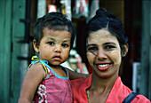 Mother and girl with Thanaka paste, Rangoon, Myanmar, Asia