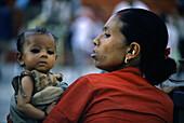 Mother and baby in Kathmandu, Kathmandu, Nepal Asia