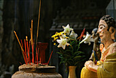 Figure and incense sticks at cave temple at Marble Mountains, Da Nang, Vietnam, Asia