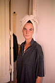 Young woman wearing a towel on her head, Berlin, Germany