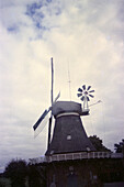 Windmill in front of cloudy sky, Emden, Lower Saxony, Germany