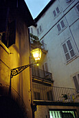 Lantern on house wall, Verona, Italy