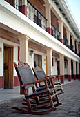 Rocking chairs on empty street, Creel, Chihuahua, Mexico