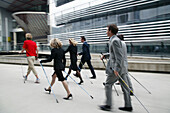 Business People doing Nordic Walking