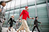 Businesspeople doing Nordic Walking