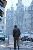 Man at the new city hall on a cold winter's day, Leipzig, Saxony, Germany, Europe