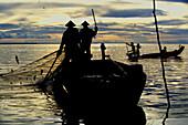 Fisherman with net, Tonle Sap Lake, Siem Reap Province, Cambodia, Indochina