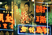 Kowloon by night reflections in shop window, , Hongkong, China
