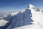 Three persons on snowcovered ridge, Nebelhorn, Oberstdorf, Bavaria, Germany