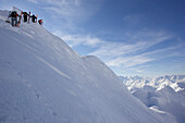 Four skier on ridge, way to extreme ski run, Nebelhorn, Oberstdorf, Bavaria, Germany