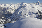 People skiing on powder snow, Nebelhorn Mtn., Oberstdorf, Bavaria, Germany