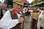 Mature man playing accordion, Simmershausen Festival, Hilders Simmershausen, Rhoen, Hesse, Germany
