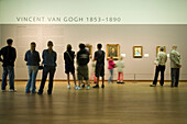 Visitors looking at paintings of van Gogh, Van Gogh Museum, Amsterdam, Netherlands