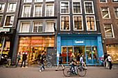 People, Shopping Street, Leidsestraat, People passing shop-windows in Leidsestraat, Amsterdam, Holland, Netherlands