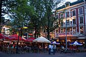 People, Restaurants and Bars, Leidseplein, Open air restaurants and bars in the evening, Leidseplein, Amsterdam, Holland, Netherlands