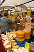 Market Stalls, Cheese, Albert Cuypstraat Market, Man buying cheese at a cheese market stall at Albert Cuypstraat Market, Amsterdam, Holland, Netherlands