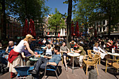 People, Sidewalk Cafe, Leidseplein, People sitting at open air cafes at Leidseplein at a sunny day, Amsterdam, Holland, Netherlands