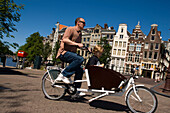 Cyclist, Keizersgracht, Father and sun cycling with a quaint Bicycle, Keizersgracht, Amsterdam, Holland, Netherlands