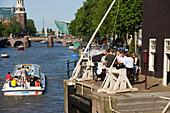 De Sluyswacht, Oude Schans, Boat, View from de Sluyswacht, a typical brown cafe, over Oude Schans to Montelbaanstoren watch tower, and NEMO Museum, Amsterdam, Holland, Netherlands