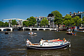Leisure Boats, Magere Brug, Amstel, Leisure boats on Amstel on a sunny day, Magere Brug Skinny Bridge, in background, Amsterdam, Holland, Netherlands