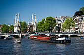 Barge, Magere Brug, Amstel, Barge passing open Magere Brug Skinny Bridge, , Amsterdam, Holland, Netherlands