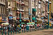Souvenir Shops, Damrak, People walking over shopping street with a lot of souvenir shops, Damrak, Amsterdam, Holland, Netherlands
