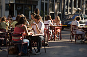 People, Provisional Open Air Restaurant, Jordaan, People sitting in a provisional open air restaurant on an extraordinary hot day, Lindengracht, Jordaan, Amsterdam, Holland, Netherlands. This special license is valid on days with over 30 degrees Celsius