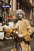 Street artist wearing fancy-dress costume like Mozart, Vienna, Austria
