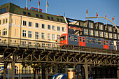 The skytrain driving on a viaduct at Baumwall, Hamburg, Germany